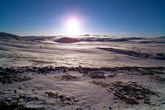 Sunrise over a snow-covered desert