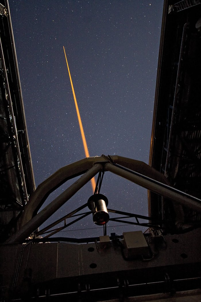 "Laser beam creating an ""artificial"" star"