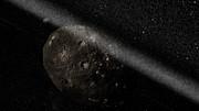 Impresión artística del sistema de anillos que rodea al planeta menor Chariklo
