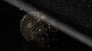 Artist's impression van het ringenstelsel rond planetoïde Chariklo