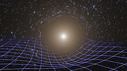 Artist's impression of massive object distorting spacetime