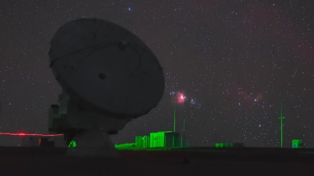 ALMA dish and the setting Orion Nebula