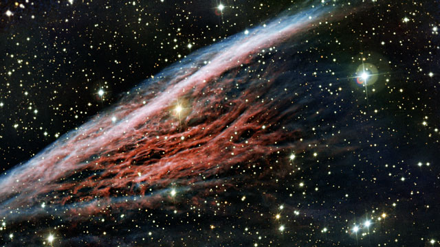 Panning across the Pencil Nebula, a strangely-shaped leftover from a vast explosion