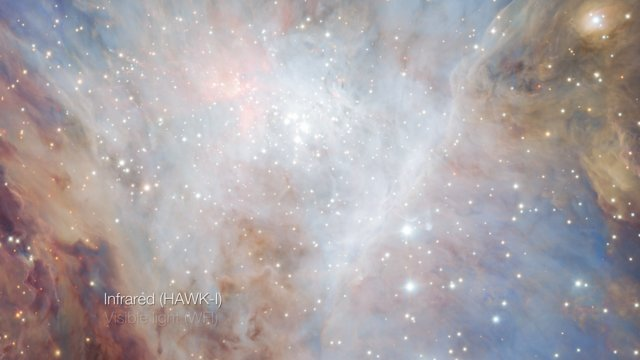 Cross-fade between visible and infrared light images of the Orion Nebula