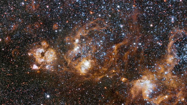 Panning across the rich region around the Tarantula Nebula in the Large Magellanic Cloud