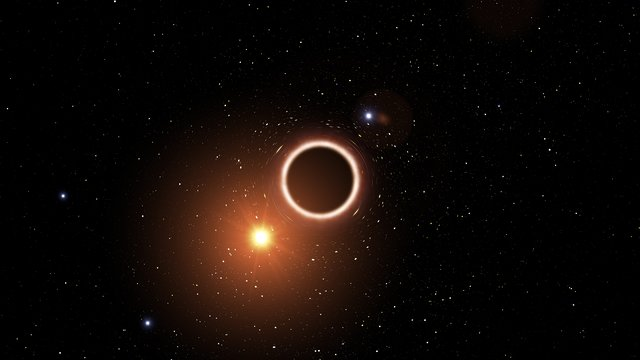Artist's impression of star passing close to supermassive black hole