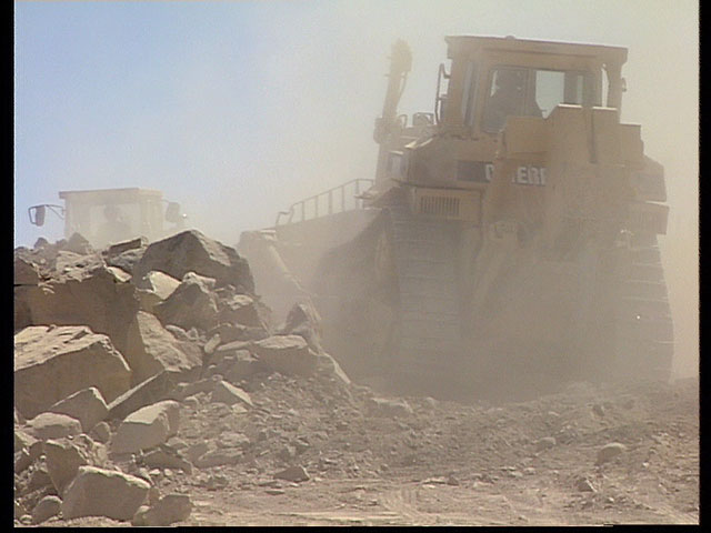 Removing debris from VLT construction, 1991 — clip 4